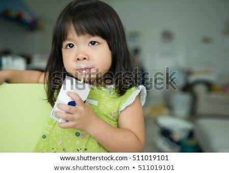 Asian girls kissing milk