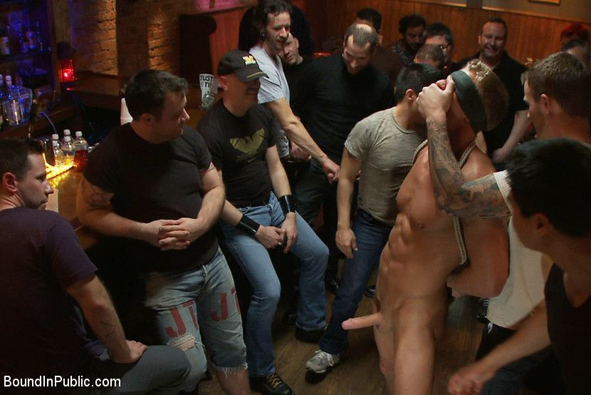 Bondage blindfolded gay group blowjob in gay bar