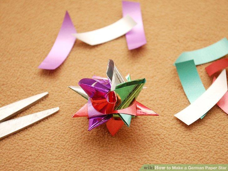 German folded paper strip birds
